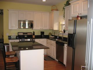 Clean kitchen - granite tops and ss appls- nat gas grill on back porch - Beach Haven townhome vacation rental photo