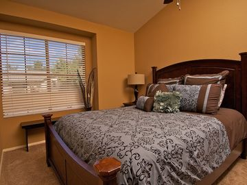 Second bedroom with queen size bed and fine furnishings.