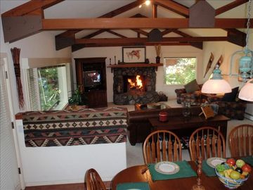 Massive stone fireplace, leather & alpine furnishings.