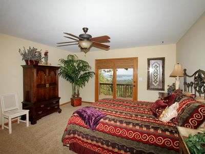 Master bedroom with doors leading to deck. Watch the sunrise from bed!