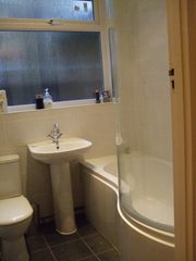 Greenwich apartment photo - Bathroom has shower and huge P shape bath