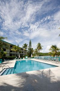 TROPICAL BEACHSIDE POOL. LOCATED 4 STEPS AWAY FROM OUR  PRIVATE BEACH.