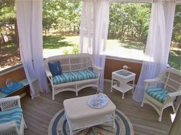 Screened porch is comfortably oufitted