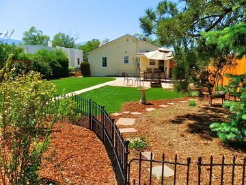 Enjoyable huge backyard with mature trees and flowers. Gas grill.