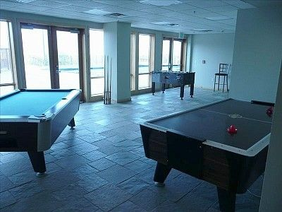 Game Room, next to fitness center & outdoor pool & hot-tubs!