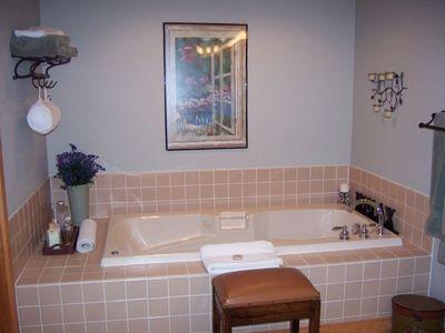 Find a jetted tub in the Master Bath and a separate room with Private Shower