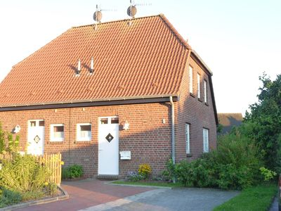 Comfortable cottage with beautiful garden in a prime location carolinensiel