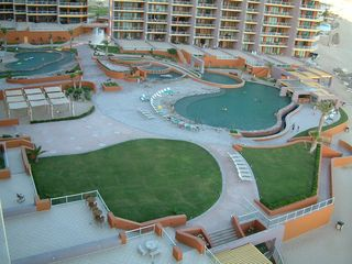 Puerto Penasco condo photo - Common area below includes pools, swim-up bar, hot tub, hammocks, and more!