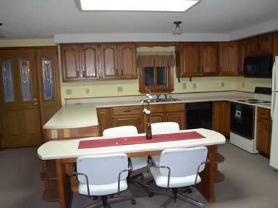 Kitchen with breakfast bar.
