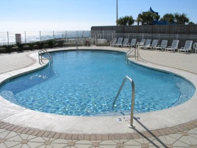 Relax in the outdoor pool at Romar Tower on your vacation!