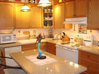 Makaha property rental photo - Kitchen with Lighted Display Cabinet