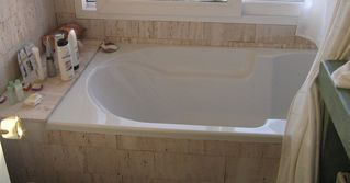 Maldonado farmhouse photo - BATHROOM: DEEP LARGE BATH TUB; TRAVERTINE MARBEL.