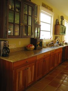 Our beautiful kitchen has cherry cabinets, granite counters, tons of work space!