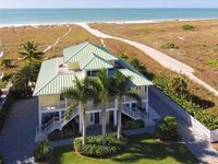 The 'BELLE OF THE BEACH'!   BEACH FRONT luxury home 1/2 mile from the Village!