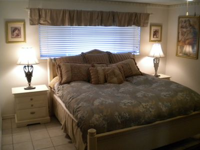 Master Bedroom#1 with King Size Bed and Beautiful Attached Bathroom.
