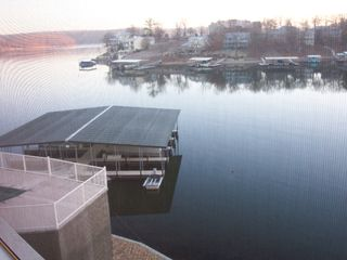 Osage Beach condo photo - Our covered boat dock looking through our screened in patio