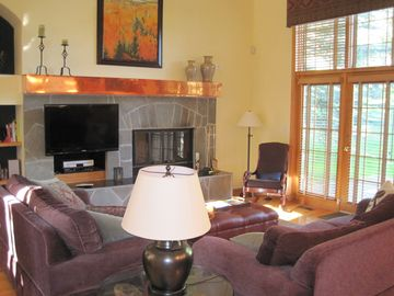 Beaver Creek townhome rental - Living room with door to patio overlooking golf course