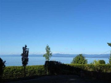 Qualicum Beach house rental - Enjoy panoramic ocean views through the picture windows of this lovely home