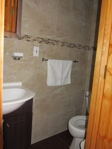 Queens condo rental - Beautifully tiled half bathroom