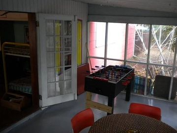 screened porch with foosball