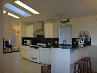 Bodega Bay house photo - New kitchen with black galaxy granite countertops and hard wood cabinets.