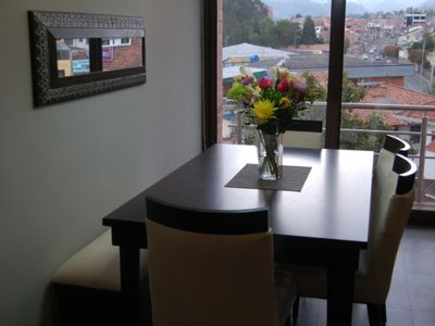 Bench seat for flexible dining arrangements. Comfortable dining chairs.