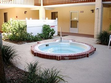 Cozy hottub just steps from the front door!