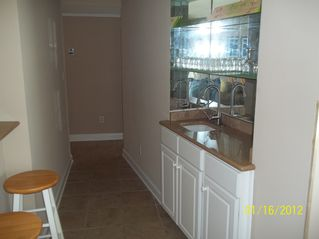Gulf Shores condo photo - Hallway with bar stools on one side and the wet bar on the other side.