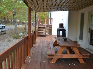 Bushkill house photo - Huge deck with outdoor fireplace