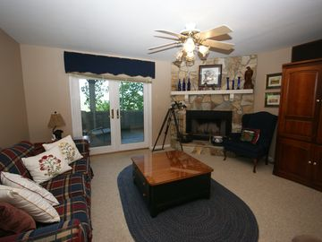 Fireplace/Two ceiling fans and armoire with games and movies for fun indoors.