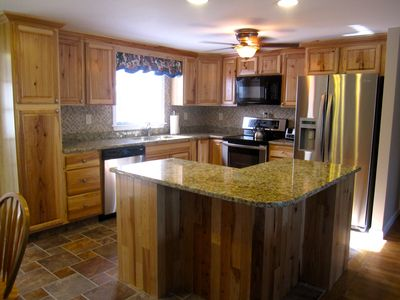 Hickory kitchen with granite counters and all stainless appliances