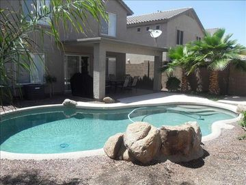 Buckeye house rental - Back yard pool with water fall feature and patio