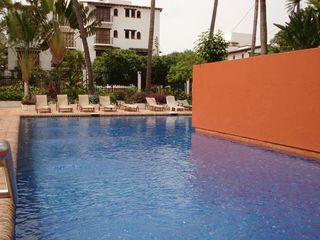 Puerto Vallarta apartment photo - Big shared pool with lush gardens around the property