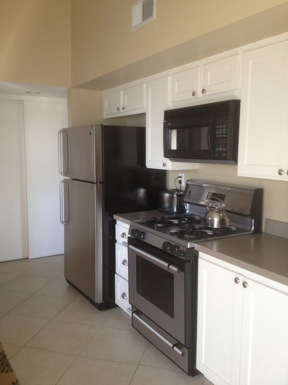 Kitchen w large pantry and stainless appliances