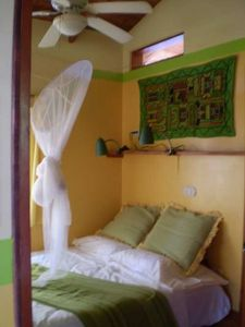 Double bed with refreshing ocean breezes, reading lamps and mosquito net.