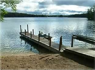 Sandy beach with two docks