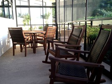Outdoor dining and relaxing rocking chairs for you to enjoy