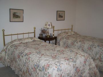 Bedroom in front of house two single beds