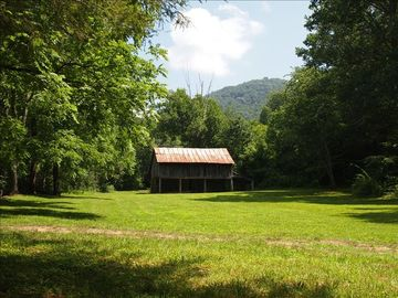 beautiful 3 acre field with barn & mountain view. 3 wooded acres to hike also.