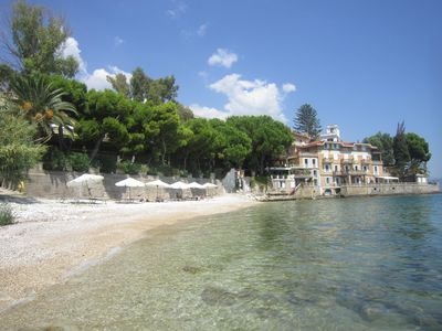 Historic villa has private beach, terraced apartments.