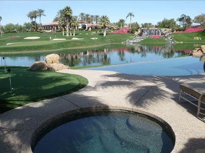 Magnificent waterfall, lake, and 18th green view with mountain vista from the pa