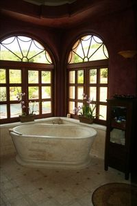 Enjoy a soak in this stone tub and bask in the magnificent views.