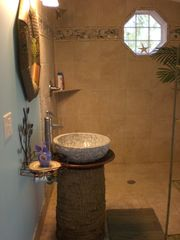 Double shower. Stone sink on palm stump. - Tybee Island cottage vacation rental photo