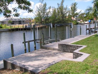 Cape Coral house rental - Canal-side patio, dock and boat lift. A great place to catch Mangrove Snappers!
