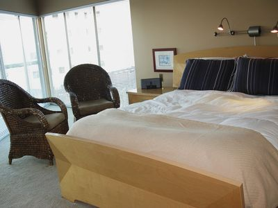 The master suite has delicious queen size bed and floor to ceiling windows.