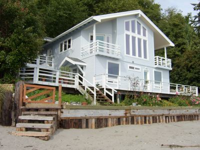 House at low tide, sandy beach,
