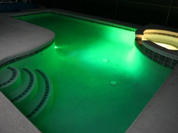 Pool and spa with fibre optic lighting