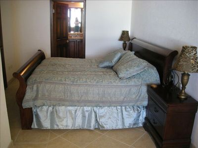 Large master bedroom with king-sized bed/pillow top mattress and bath
