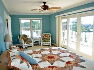 Bethany Beach house photo - The master bedroom also features a seating area and an attached deck.
