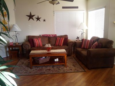 Spacious open living room with wood floors throughout.